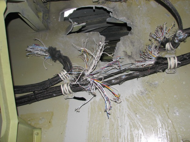Damage to electrical wiring located in the leading edge of the left wing