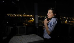 MIA employee Khristine Perez works a ground tower in the dark after a power outage
