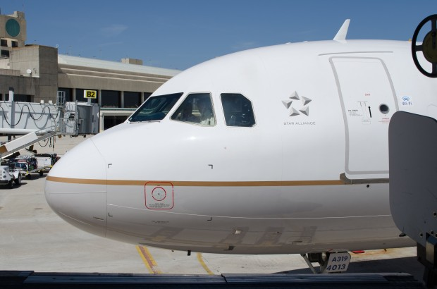 A United Airbus A319 pulls up to the jet bridge at PBI