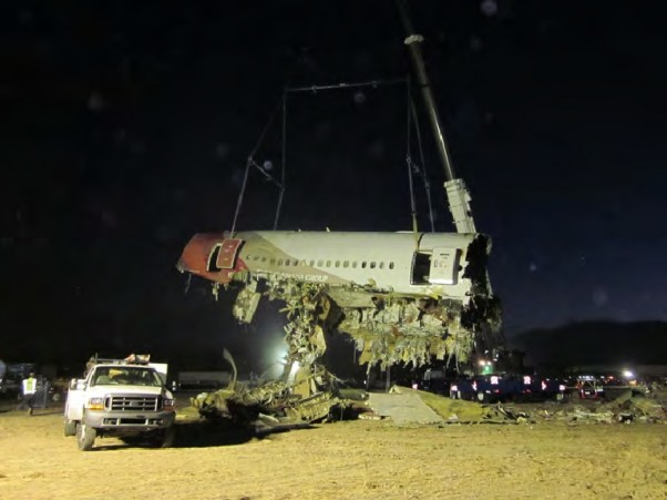 Lifting a portion of the Asiana 214 fuselage off the runway at SFO
