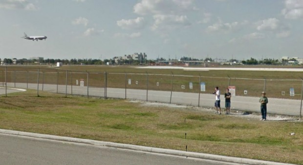 "These spotters at MIA's ""The Holes"" location aren't quite sure what to look at. The passing Google street view car, or the airplane! (Credit: Google)"