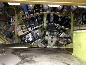 pic of electronics bay of Southwest 737 at LGA penetrated by landing gear. Only right axle attached.