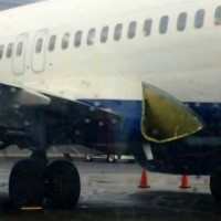 A damaged Delta Boeing 737 sits out of service at JFK.
