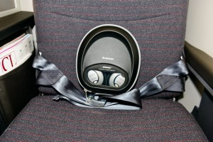 Bose noise canceling headphones are offered to all First and Business Class passengers, along with a pillow and blanket.