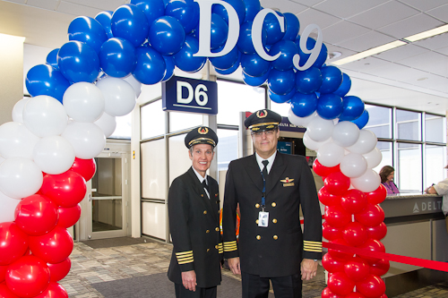 Captain Scott Woolfrey, pilot in command of Delta 2014, and Captain pose at the gate during pre-flight festivities.