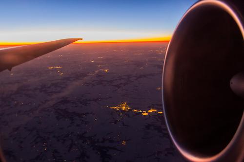 Watching the sun set at cruising altitude.