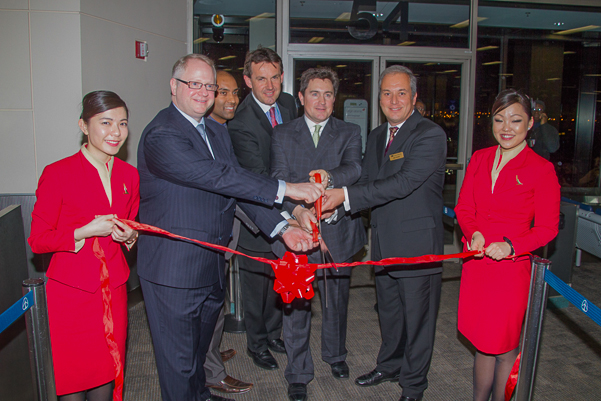 Cutting the ribbon on Cathay Pacific's service from Newark to Hong Kong.