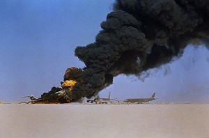 Huge columns of smoke pour from the wreckage of three airliners destroyed by Palestine Liberation Organization guerillas at Dawson's Field in the Jordan desert.