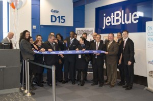 JetBlue and DTW officials perform the ceremonial ribbon cutting at Gate D15