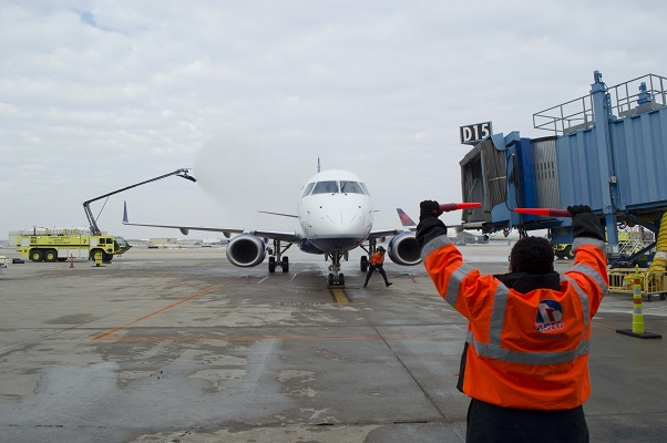 JetBlue's first flight into Detroit receives a water cannon salute at the gate.
