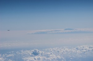 Another aircraft far off our wing as we began our descent into HNL.