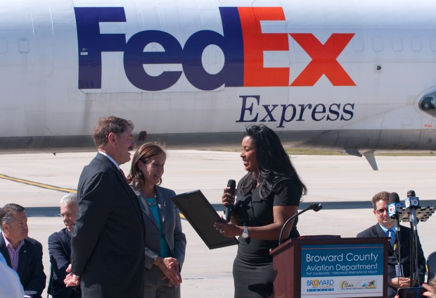 Broward County Mayor Barbara Sharief presents proclamation to David Sutton and Beth Rush from FedEx