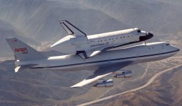 NASA 905 shown ferrying Space Shuttle Discovery. (Photo courtesy of NASA)