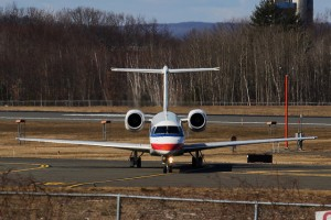 "With too much fuel and too many passengers onboard to takeoff safely, this American Eagle ERJ heads to the ""penalty box"" at BDL to burn off some fuel."
