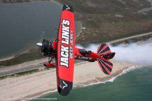 Jeff Boerboon flys the jack Links Jet Waco for the camera over Jones Beach.