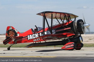 Jeff Boerboon waves to the crowd in the new Jack Links Beef Jerky Jet Waco. Photo Scott Snorteland
