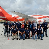 Members of the Miami Airport Watch Program pose alongside MIA airport personnel and a 21 Air 767, (Photo: Miami Airport Watch)