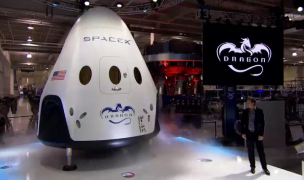 Meet Dragon V2 – SpaceX CEO Elon pulls the curtain off manned Dragon V2 on May 29, 2014 for worldwide unveiling of SpaceX's new astronaut transporter for NASA. Credit: SpaceX