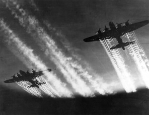 Contrails stream out of the four Wright 1820 radial engines on these B-17 bombers during World War II.