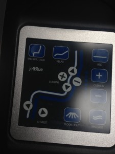"""A bevy of seat controls is complemented by a 15"""" display offering DirecTV and movies. (Photo by the author)"""