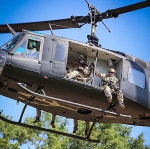 Rich Graham (inside, center), arriving into action in the sweet ride of a Bell UH-1.