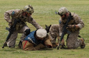 Rich (right), in a training display with his famed K-9 sidekick, named War Beast.