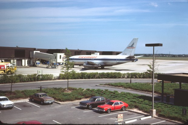 A Piedmont Airlines 737-200 is parked at its gate in Norfolk.
