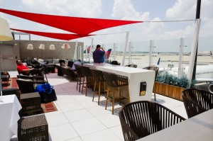 The outdoor deck of the Delta SkyClub allows for prime aircraft viewing while sipping an adult beverage.