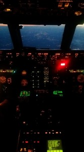 The typical view from an airliner jumpseat, seen here in a descending MD-80.
