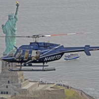 A sightseeing helicopter circles over the Statue of Liberty (Photo:Skyride.com)