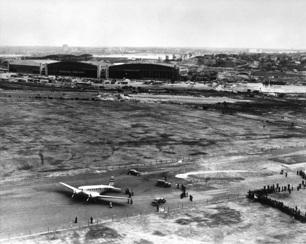TWA DC-2 sitting at LGA in the late 1930s, with American Airlines Hangars 1, 3 and 5 in the background. (Jon Proctor)
