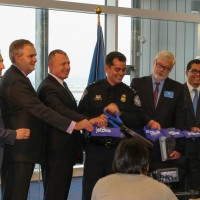 Officials from JetBlue, Customs and Border Protection, the Port Authority of New York and New Jersey, and the New York City Economic Development Corporation cut the ribbon on  the new T5i wing.