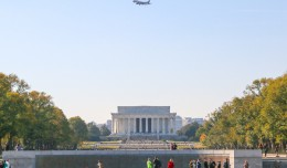 A JetBlue E190 flies over the Lincoln Memorial, as viewed from the World War II Memorial.