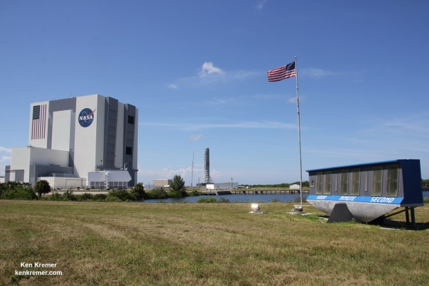 Famous KSC Press Site Countdown Clock and US Flag with VAB during SpaceX CRS-4 launch in September 2014. Credit: Ken Kremer – kenkremer.com