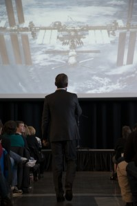 Col. Chris Hadfield describes life onboard the International Space Station to a packed house at the Future of Flight – Photo: Kris Hull