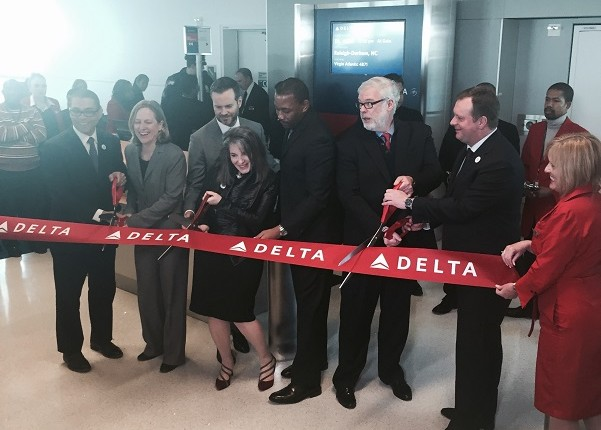Official pose prior to the ceremonial ribbon cutting for the Terminal 4B extension. (Photo: Douglas Wint).