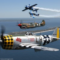 This unique formation of the American Airpower Museum's P-47 and P-40 with John Klatt Airshows took place Saturday before the show over the beach.  Photo Scott Snorteland