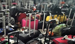Hundreds of post-convention bags wait to be sent to their flights. Photo by Paul Thompson.