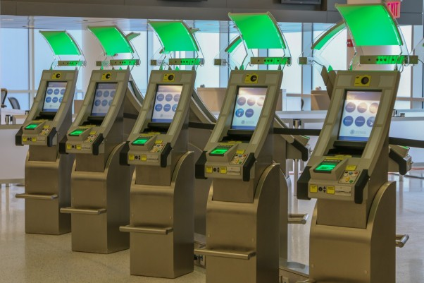 Automated Passport Control kiosks from SITA at JetBlue's JFK Customs Facility. Photo courtesy Ben Granucci, NYCAviation.