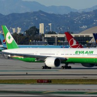 An EVA AIr Boeing 777-300ER taxies for departure at LAX, with another in the background.