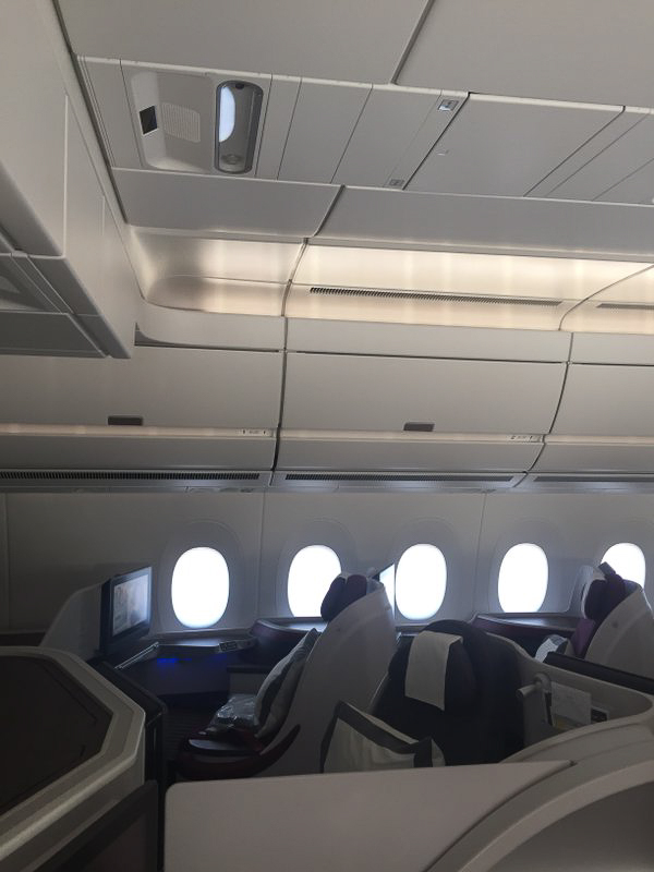 The seats in the center section have individual reading lights, but no personal air vents. If you prefer that stream of air while flying, choose a window seat.
