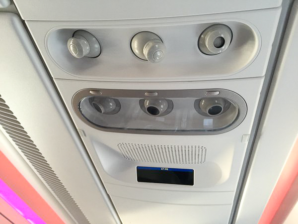 Each economy class seat has its own reading lamp and air vent. the black rectangle is an LCD display that can be programmed to display things like seat numbers, the 'fasten seatbelts' sign, and certain other information for passengers.