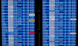 Departure_And_Arrival_Board_At_Dulles_Airport_(4128589658)