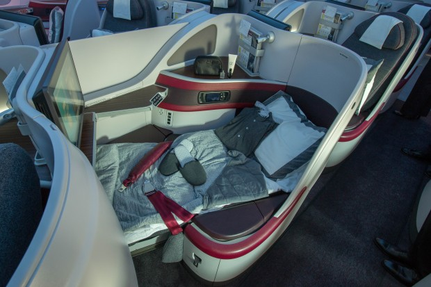 The business class seats are fully lie-flat and very comfortable. Unlike some other seats, they don't leave you feeling like you're laying on the floor. Pajamas, slippers, a pillow, and a duvet are all provided.