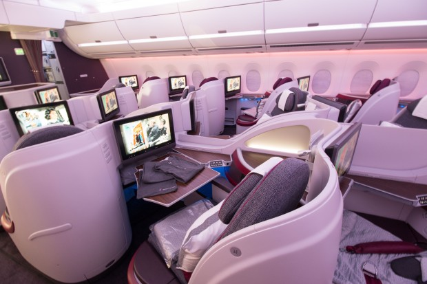 The inflight entertainment screens and tray tables at each business class seat are very large.
