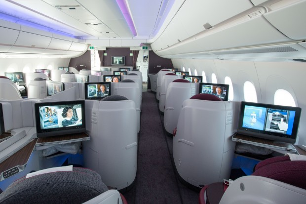 """Business class seats are arranged in the popular outward-facing or """"reverse"""" herringbone configuration."""
