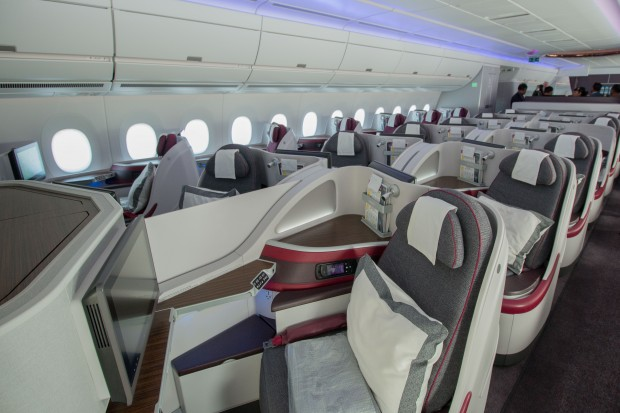 Seats in the center section have a divider that may be raised or lowered, depending on the desires of the occupants.