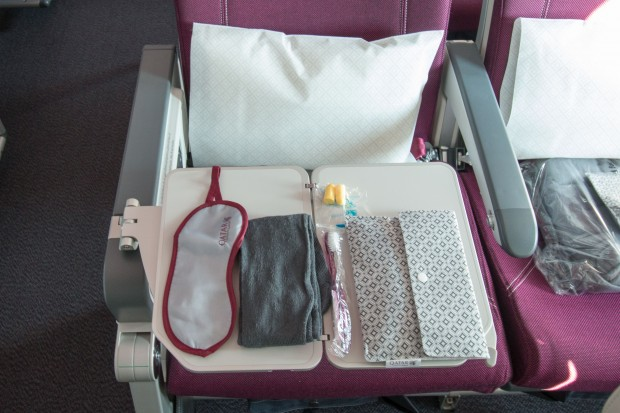 Even passengers in economy get a small amenity kit. It includes an eyemask, earplugs,