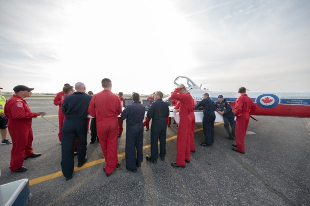 The Royal Canadian Air Force Snowbirds debrief after flying their jets into Republic Airport.