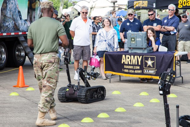 The US Army's Explosive Ordnance Disposal tech hands on display. They had two bomb disposal TALON robots setup for the public to test drive: send them down range, retrieve an object and return. Note to the Air Force: the Army is showing you up - more interactive, hands on opportunities to operate your equipment, please?